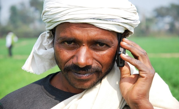 Farmer with his mobile phone in Bihar, India